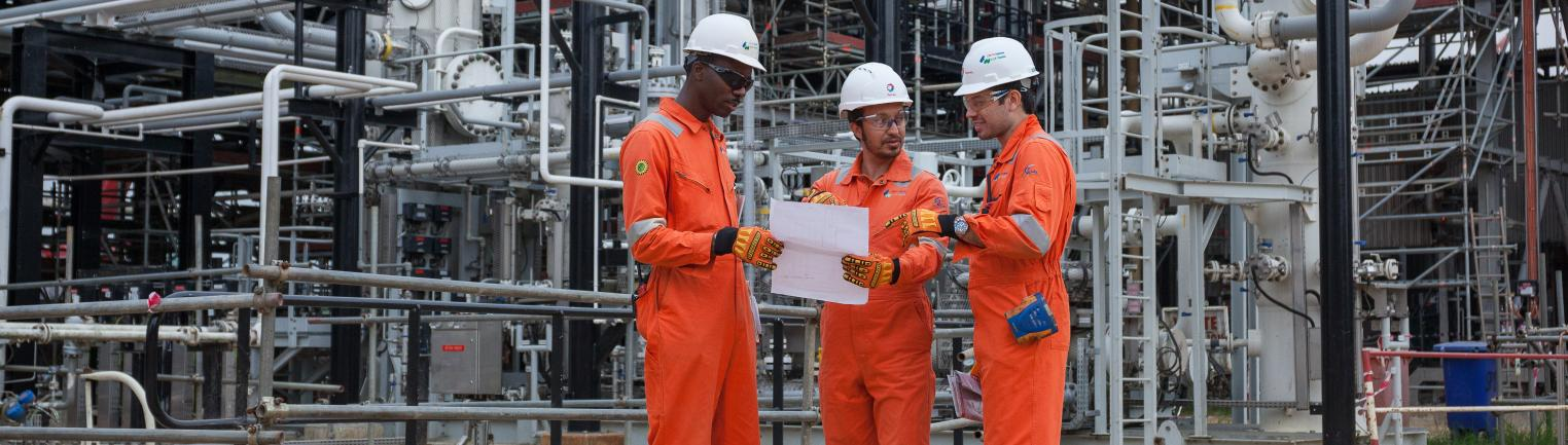 Operators carry out an inspection at a pumping station in Ogbogu, Nigeria.