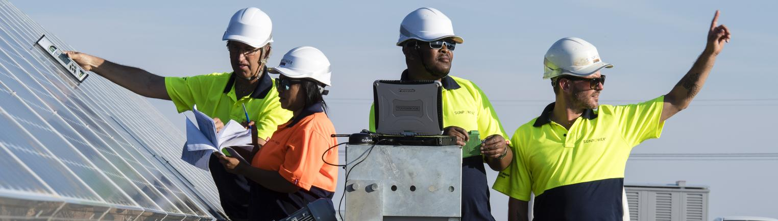Operators at the SunPower solar plant in Prieska, South Africa.