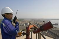 Operator from the top of a storage tank at the LNG terminal in northwestern India.