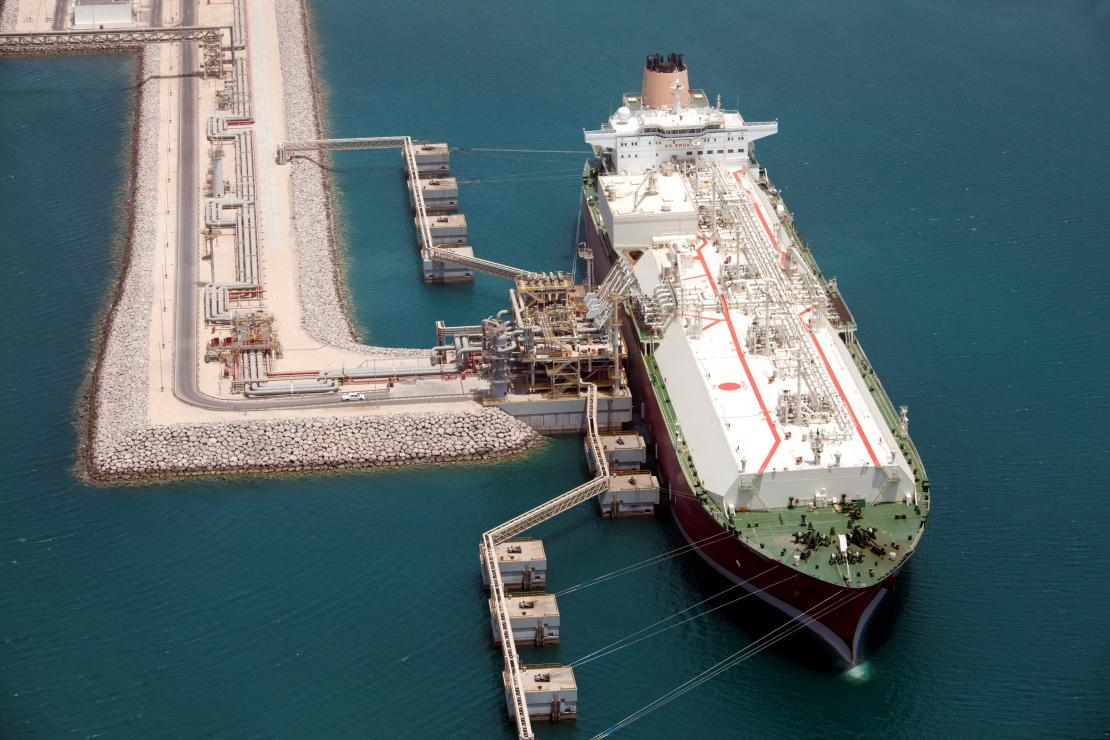 Liquefied natural gas is loaded onto an LNG carrier