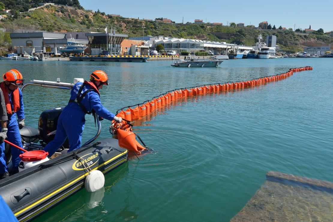 Marine firefighters demonstrate oil spill response equipment